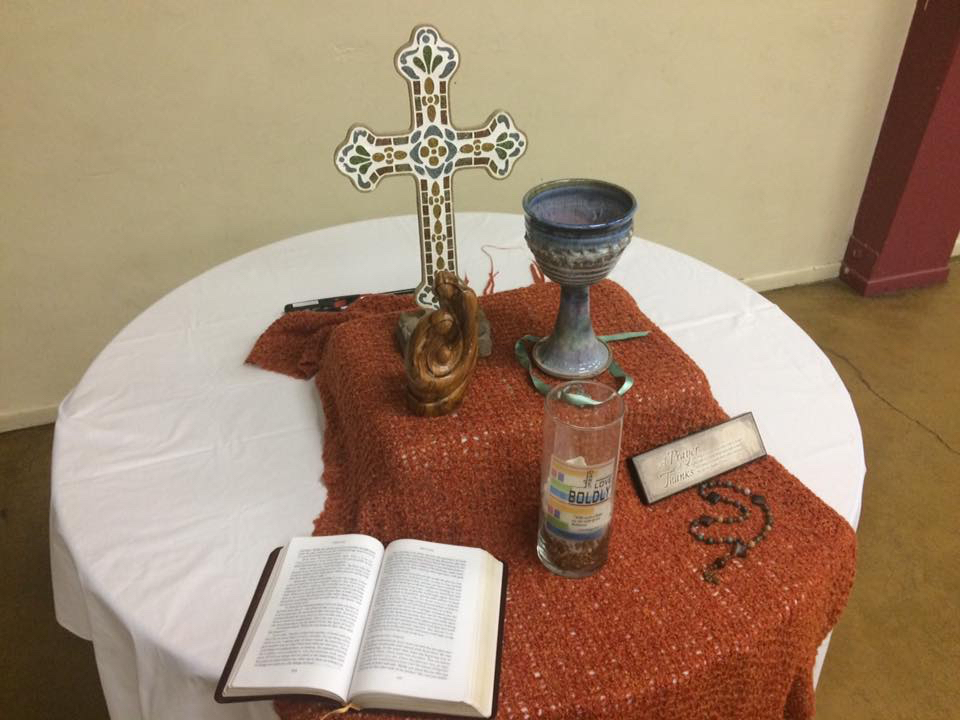 Communion table with Chalice and candle at Mission First event in Phoenix