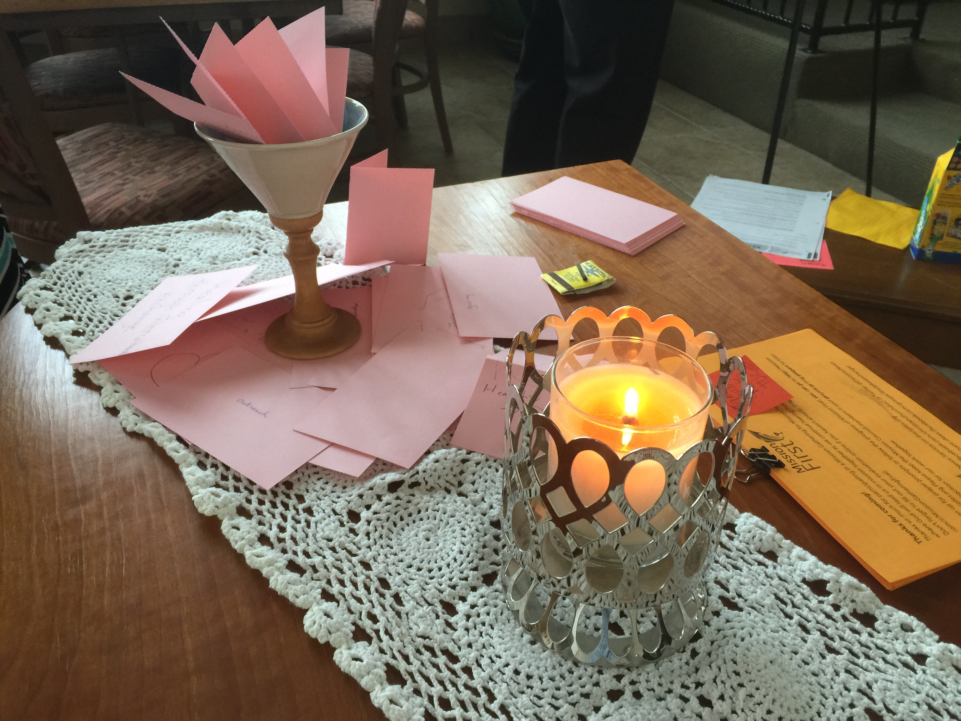 Communion table with Chalice and candle at Mission First event in Tucson